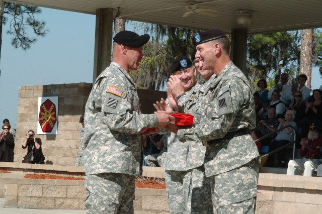 Third Infantry Division Command Sgt. Maj. Jeffrey Ashmen (left) presents a two-star flag to Maj. Gen. Jeffrey E. Phillips during a Retreat Ceremony at Fort Stewart's Marne Garden, March 25. Soldiers, civilians and Family Members bid farewell to Maj. Gen. Phillips, who served 18 months as the division's deputy commanding general. He was promoted to major general during the ceremony.
