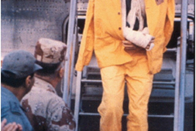 Maj. Rhonda Cornum, now a brigadier general, steps off the plane upon her release from Iraqi captivity, March 6, 1991, during Desert Storm.