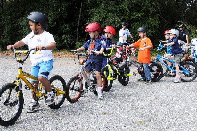 Cub Scout Pack 50 members line up at their annual bicycle rodeo behind the Post Exchange Sept. 27. The Cubs learned about bike safety and rode around Fort Rucker with their parents and Scout leaders. Bike safety is again becoming an issue at Fort Rucker as the weather gets better.
