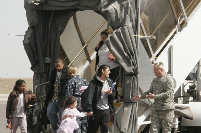 Military family members deplane March 25, at the Denver International Airport during their evacuation from the devastation in Japan.