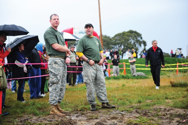 SEASIDE, Calif. - Military volunteers wait adjacent to the final mud pit for the first runners to arrive.