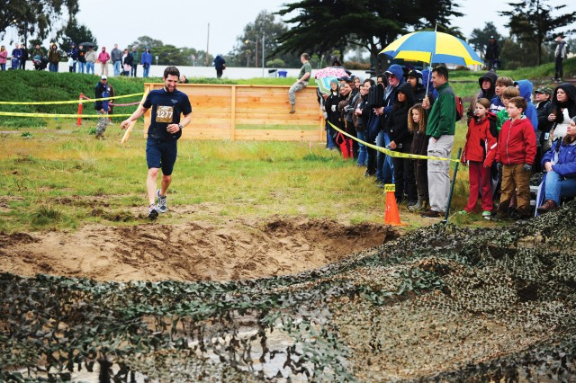 SEASIDE, Calif. - Ben Ballister becomes the first competitor of the morning to reach the final mud pit.