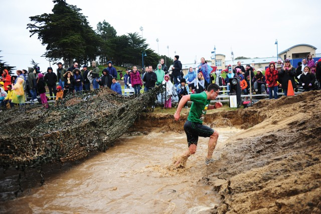 SEASIDE, Calif. - Carlos Ventura races past spectators gathered at the final mud pit on his way toward a first-place finish, military division.