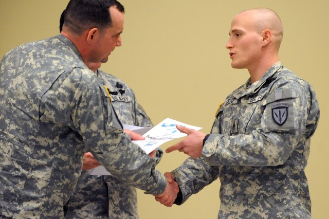 Command Sgt. Maj. Joseph Dallas, 5-20 Infantry, 3rd Brigade, 2nd Infantry Division, presents Staff Sgt. Bryan Senz, C-38th Long Range Surveillance, with a Pathfinder badge.