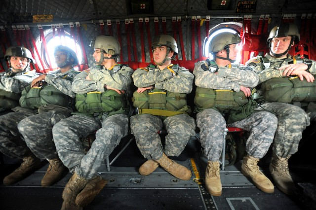 Soldiers prepare to perform a static line parachute jump from a CH-47 Chinook helicopter March 18, near Rogers Drop Zone, Joint Base Lewis-McChord, Wash.
