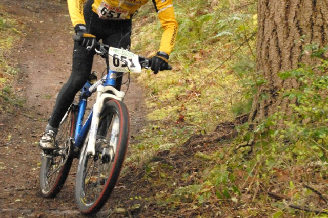 Pat Dale negotiates a turn during the annual JBLM Xtreme Mountain Bike Race March 26.  Dale outraced five other riders to win the sport class.