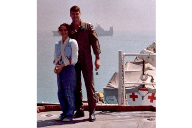 Maj. Rhonda Cornum, now a brigadier general, and her husband stand on the deck on a Navy hospital ship in the Persian Gulf shortly after her release from Iraqi captivity in March 1991.