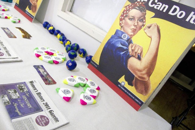 A table of women's history artifacts is displayed at Fort Meade's annual Women's History Month observance March 24.