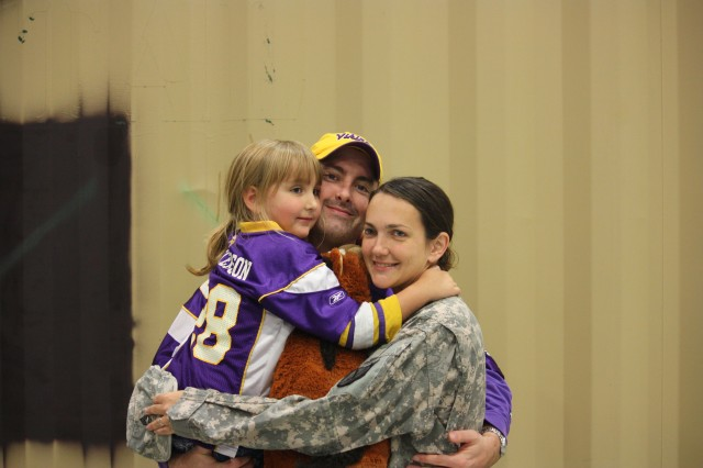 Sgt. 1st Class J. R. Williams with her husband, Jason and daughter, Reilly.