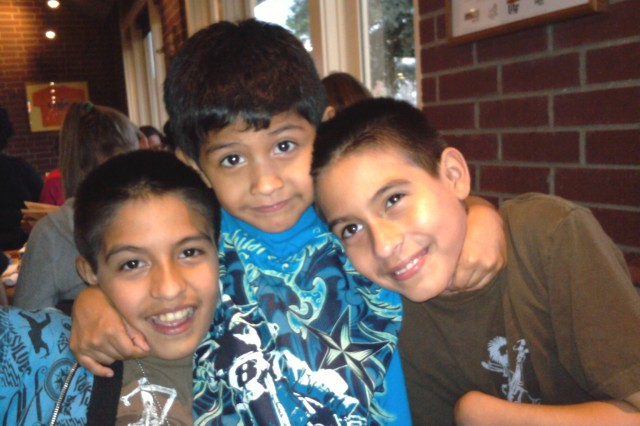"From left: Nathan, Alex and Angel Guereca. Together with their mom Patty and older brother Rolando, the boys were featured on ""Sesame Street's"" ""Talk, Listen, Connect: When Families Grieve,"" talking about their experiences after their dad, Sgt. Joe Guereca, was killed in combat"