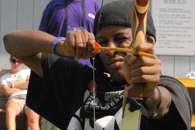 Jeremy Beale tries his hand at archery during Operation Purple Camp.