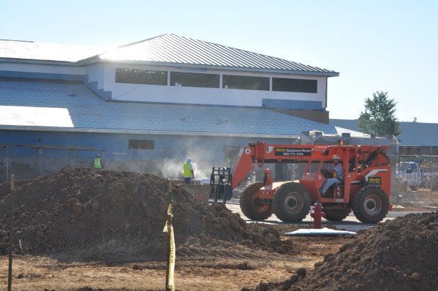 Workers continue construction on one of two identical Child Development Centers on Bastogne Avenue, across from Fort Campbell High School. Once complete, each center will create 195 child care slots.