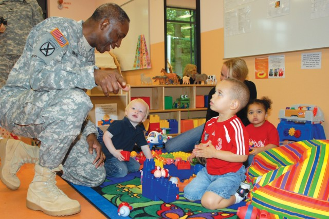 "Gen. William E. ""Kip"" Ward, commander of U.S. Africa Command, meets (from left) Jackson Boyle, 22 months, Anthony Richards and Arianna Wilson, both 2, after the Kelley Child Development Center ribbon-cutting ceremony, Aug. 23, 2010, in Stuttgart, Germany. The center provides full day care to 86 children, from 6 weeks to kindergarten age. The old CDC now offers hourly care and half day care."