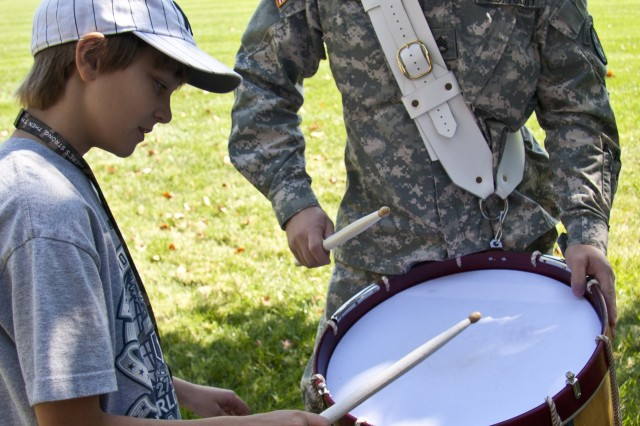 Staff Sgt. Scott Jamison, U.S. Army Old Guard Fife and Drum Corps snare drum instrumentalist, performs with a student from the 2010 Old Guard Juniors' Workshop.
