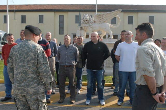 Maj. Gen. David R. Hogg, Commander, U.S. Army Africa, welcomes Soldiers on their return to the command's headquarters in Vicenza, Italy, after a shipboard deployment to the USS Mount Whitney in support of Operation Odyssey Dawn.