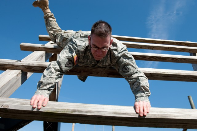 Spc. Bernard Quackenbush, an avionics and survivability repair technician from the Army Research Laboratory, navigates over, around and through an obstacle course March 30 as part of the U.S. Army Research, Development and Engineering Command\'s week-long Noncommissioned Officer and Soldier of the Year competition.
