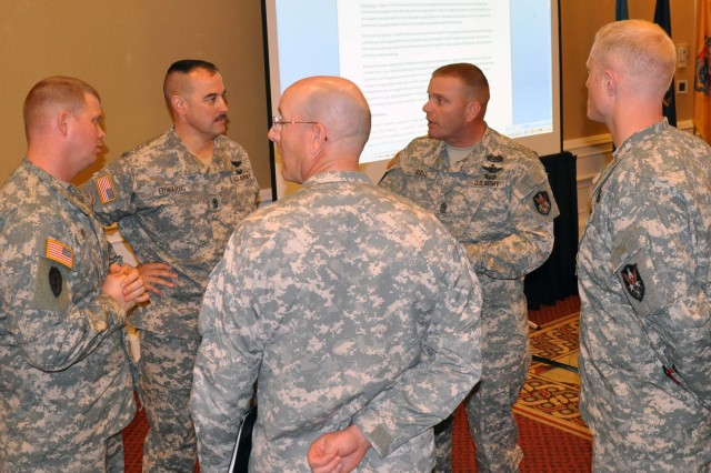 1st Space Brigade Command Sgt. Maj. James N. Ross (second from right) briefs the group of Soldiers who made up his brigade's panel discussion on the Profession of Arms during the Senior Enlisted Leaders Training Conference that took place at Patrick Air Force Base, Fla., March 21-24.