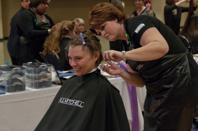 Sgt. Mandy Alward, Company B, Warrior Transition Battalion, gets her hair cut during the Salute to Female Wounded Warriors, March 28.