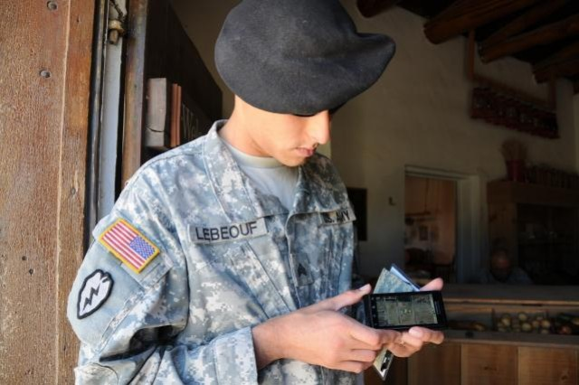 Sgt. Willie LeBeouf from Houston, Texas, assigned to the 5th Brigade, 1st Armored Division, Army Evaluation Task Force, selects a local map to display on a smart phone. The phone was loaded with a special application to help Soldiers interview local residents during a battle scenario as part of an exercise the unit recently participated in at Fort Bliss, Texas.