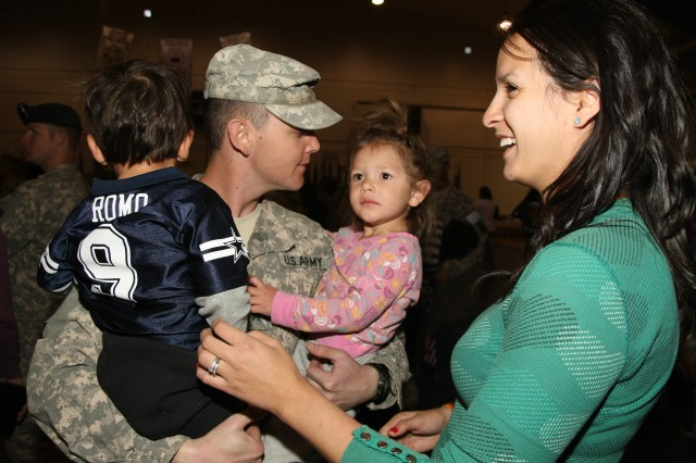 Friends and family members gathered at Barnes Field House, March 24, with banners and signs to welcome home the Soldiers of the 86th ESB.
