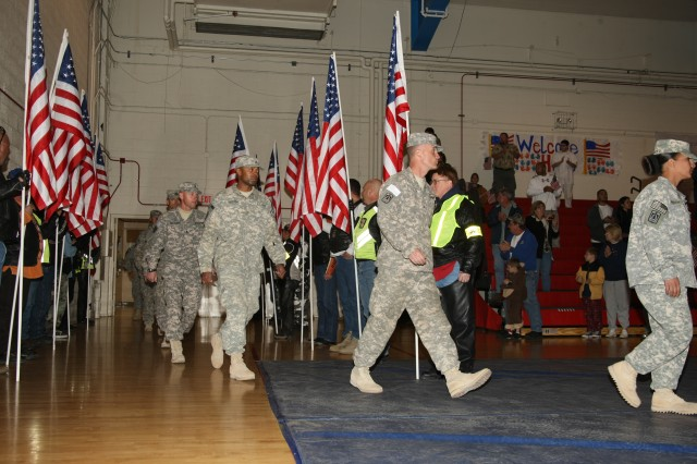 The Soldiers were met with thunderous applause when they finally made their entrance at Barnes Field House after a yearlong deployment.