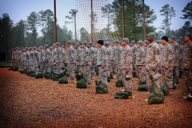 Prospective Air Assault students line up before taking their turn at the obstacle course on 'zero day,' the first day of course training March 29, at Fort Benning, Ga.