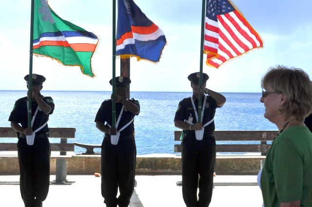 A police color guard presents arms as U.S. Ambassador to the Marshall Islands Martha Campbell walks down the Ebeye pier March 17. Campbell was accompanying Frankie Reed, the deputy assistant secretary for this region, on a trip to Ebeye to meet with local officials.