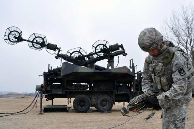 Spc. Dustin Cantu leads his team through a semi-annual Patriot gunnery evaluation on Suwon Air Base in South Korea.