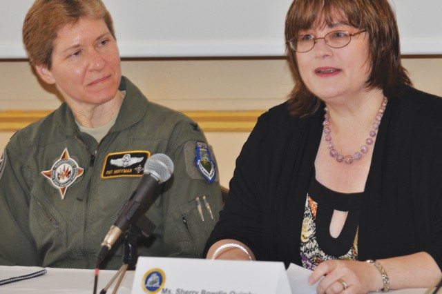 Panel member Col. Patricia D. Hoffman (left), the U.S. European Command commander's deputy foreign policy advisor (military), listens as fellow panelist Sherry Bowdin-Quimby, EUCOM intelligence lead exercise officer, shares her success story during the U.S. Army Garrison Stuttgart Women's Leadership Forum March 24 on Patch Barracks.