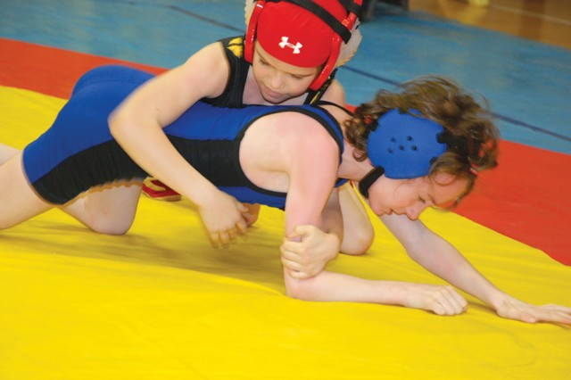 Stuttgart's Gabby Peltier, 9, keeps pressure on Hohenfels' Eric Dietrich, 8, during the Child, Youth and School Services regional wrestling tournament March 26 at the Patch High School gym.