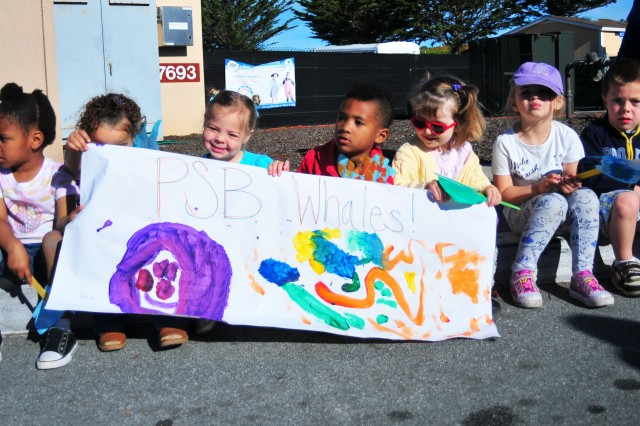 PRESIDIO OF MONTEREY, Calif. -- Monterey Road Child Development Center staff, children, parents and volunteers participate in a parade April 1 to celebrate the Month of the Military Child. Additional photos are available at Presidio of Monterey on Flickr: http://www.flickr.com/photos/presidioofmonterey/sets.