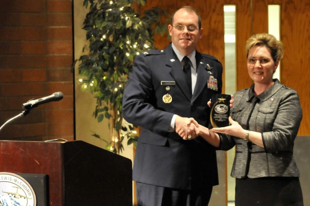 Air Force Col. Richard G. Moore, 62nd Airlift Wing vice commander, presents Tamara Jenkins, mayor of the city of DuPont, Wash., a plaque in recognition of Women's History Month on Joint Base Lewis-McChord, Wash., March 28. Mayor Jenkins was the guest speaker during the annual event, as she spoke about women's history and future. (Photo Sgt. Cesar Padilla, 20th Public Affairs Detachment.)