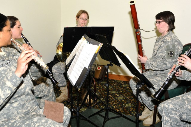 """The 56th Army Band female quintet provided the music for this year's Women's History Month; Our History is our Strength!"""" on Joint Base Lewis McChord, Wash., March 28. The annual celebration gave Soldiers and Airmen a chance to celebrate current and past women and their accomplishments. (Photo by Sgt. Cesar Padilla, 20th Public Affairs Detachment)"""