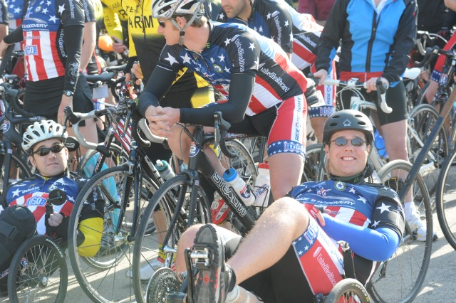 From right, Nathan Green, a retired airman who was wounded in 2008 during an insurgent rocket attack against the U.S. Embassy in Baghdad, Iraq, and Staff Sgt. Patrick Zeigler, who was wounded during the Nov. 5, 2009, shootings at Fort Hood, pause with fellow riders during a ceremony held March 31, at the flagpole near the III Corps and Fort Hood, Texas, Headquarters building.