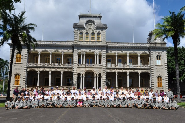 Army Reservists from the 9th Mission Support Command's 100th Battalion, 442nd Infantry Regiment, join World War II veterans from the 100th Infantry Battalion, 442nd Regimental Combat Team and the Military Intelligence Service March 28, at Iolani Palace, Honolulu.