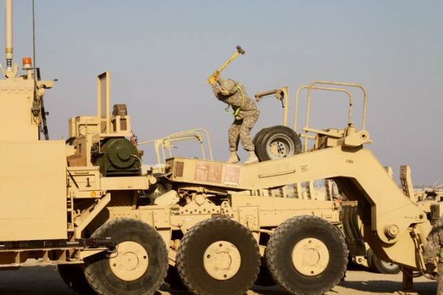 On April 1, 2011, Sgt. James Bartee working on one of the 778th Transportation Company's Heavy Equipment Transport vehicle, trying to get it ready to go on an upcoming mission in Kuwait.