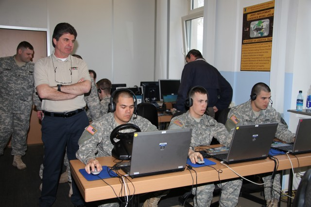 Soldiers engage in a tactical gaming simulation at the Joint Multinational Simulation Center in Bldg. 3005 on Panzer Kaserne in Kaiserslautern, Germany. The new simulation center opened March 28.