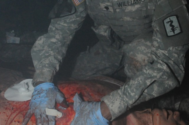 Spc. Dorian Williams, a chemical, biological, radiological, nuclear specialist and combat lifesaver from the 557th Medical Company (Area Support), provides first aid to a simulated casualty at the Medical Simulation Training Center in Vilseck, Germany, March 30.