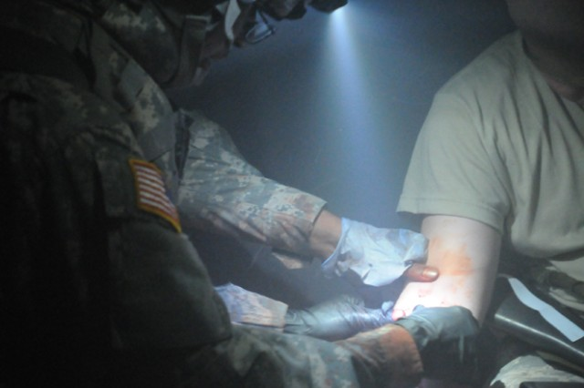 Pfc. Lashun Douglas, a combat medic with the 557th Medical Company (Area Support), provides first aid to a simulated casualty at the Medical Simulation Training Center in Vilseck, Germany, March 30.