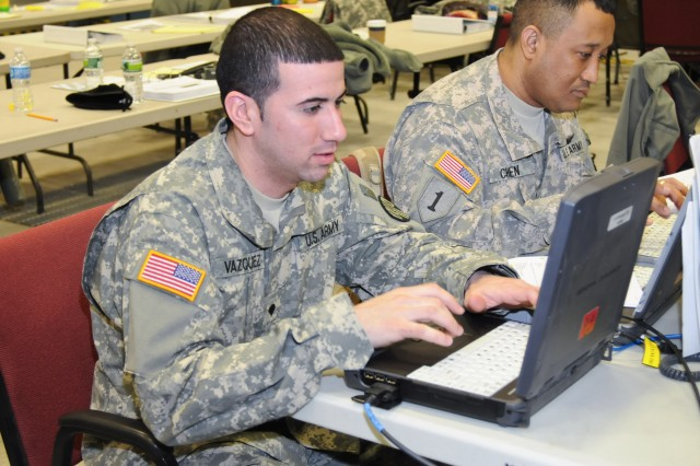 New York Army National Guard Spc. Emmanuel Vazquez and Staff Sgt. Robert Chen conduct Command Post Node training while learning about the new Warfighting Information Network-Tactical system at the New York Maneuver Area Training Equipment Site, on March 16. The two signal Soldiers are members of the 101st Signal Battalion, which is preparing to deploy to Afghanistan in 2012.
