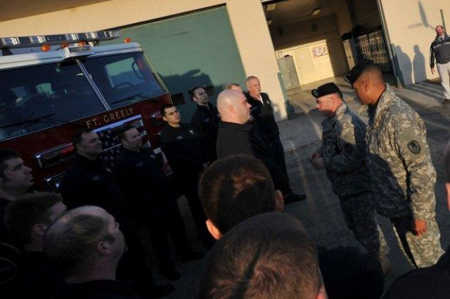 On March 30, Lt. Gen.Richard P. Formica, commanding general, U.S. Army Sace and Missile Defense Command/Army Forces Strategic Command, and Command Sgt. Maj. Larry S. Turner, USASMDC/ARSTRAT stand before firefighter Tony White to present him with the Department of the Army Achievement Medal for Civilian Service. White won the DoD Civilian Firefighter of the Year 2010. White, who is directly responsible for organizing and developing the Advanced Life Saving ambulance units and their inventories, has given more than 630 total hours of life saving instruction to Fort Greely and the surrounding communities and more than 11,000 volunteer hours in 2010. White is recognized for his ability to deliver unparalleled performance.