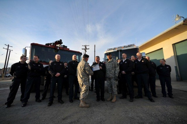 On March 30, Lt. Gen. Richard P. Formica, commander, U.S. Army Space and Missile Defense Command/Army Forces Strategic Command, and Command Sgt. Maj. Larry S. Turner, USASMDC/ARSTRAT, stand with Fort Greely's fire department and fire chief, Jim Degnan, to present the team with a certificate of appreciation for their dedication and selfless service. The Fort Greely Fire Department won Fire Department of the Year (Small Department) 2010. With 43 firefighters, three structural engines, two crash vehicles, one medium rescue with hazardous material and decontamination trailers, two wildland firefighting apparatuses, technical rescue equipment two 6x6 wheelers and two snow machines, the department helps to protect 7,200 acres on Fort Greely, 653,000 adjacent acres of mountainous terrain and the Missile Defense Agency's Interceptor missile emplacement that stands ready to defend all 50 United States.