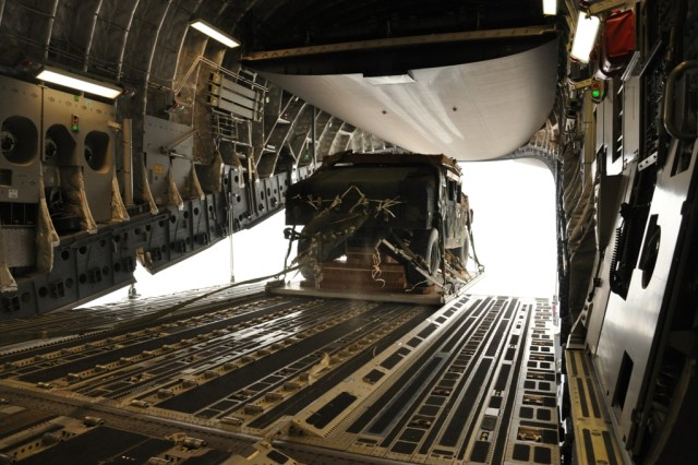FORT BRAGG, N.C. - A Humvee flies from the C-17, shattering retainers on it's parachute. It was followed by shortly by a trailer. It would be followed the next day by Paratroopers. (Photo by Spc. David L. Nye, 4th Brigade Combat Team, 82nd Airborne Division Public Affairs)