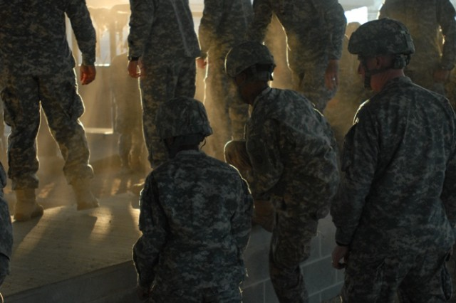 POPE ARMY AIRFIELD, N.C. - Tuesday morning, Paratroopers go through sustained airborne training, practicing the techniques essential to navigating the airborne operations safely. After the training they'll don parachutes and board a C-17.  (Photo by Spc. Victor Ayala, 49th Public Affairs Detachment (Airborne))