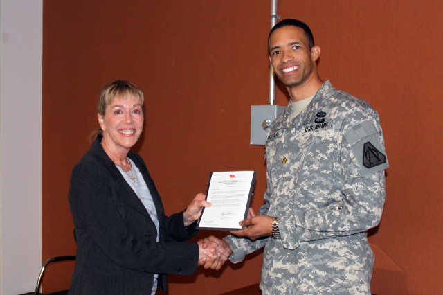1188:  Brig. Gen. N. Lee S. Price, program executive officer of Command, Control, Communications-Tactical (PEO C3T), presented Maj. Anthony Douglas, assistant product manager for Blue Force Tracking (BFT), with an honorary one-star note of appreciation on March at Aberdeen Proving Ground, Md.