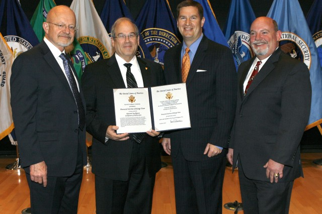 Award presentation to Richard Russell.  From Left to Right:  The honorable James Clapper, Director of National Intelligence; Richard Russell, Senior National Intelligence Service, Deputy G-2 for AMC; David McGhee, Department of State; Michael Kennedy, Director of Intelink.