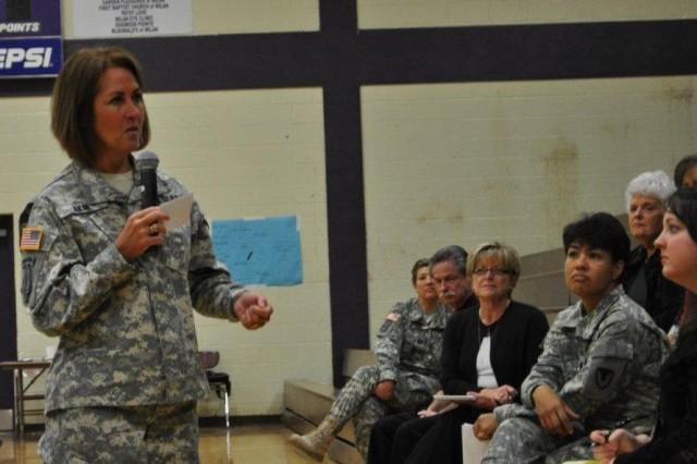 Milan, Tenn. - Brig. Gen. Robin Akin (left), commander for the 3rd Sustainment Command (Expeditionary), addresses the Milan High School senior class on topics of teamwork, courage, and planning, in honor of Women's History Month on March 31, 2011. Included in the audience are member of the Milan Army Ammunition Plant staff and Lt. Col. Maria Eoff (right), commander for MLAAP.