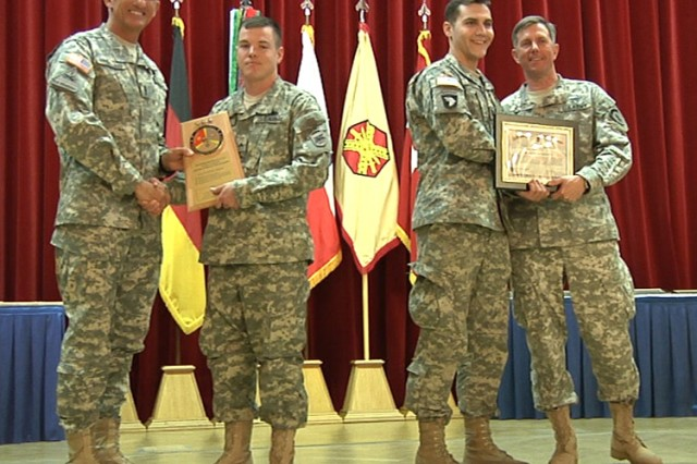 Lt. Gen. Mark P. Hertling (left), Commander, U.S. Army Europe, congratulates Cpl. Ben Roalson, Headquarters Support Company, USARAF, while Brig. Gen. Paul L. Wentz (far right), USAREUR G-4 Deputy Chief of Staff, congratulates Capt. Craig Porte, USARAF HSC executive officer, on receiving the Chief of Staff, Army, Award for Supply Excellence during a Combined Logistics Excellence Awards ceremony at the Patrick Henry Village Pavilion in Heidelberg, Germany, April 5.