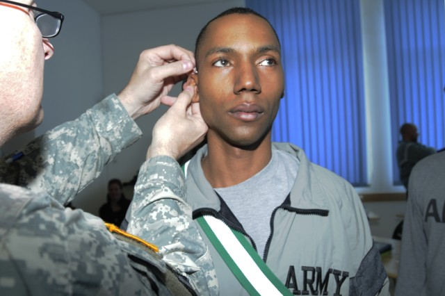 Sgt. 1st Class Tyrone Clayton, human resources sergeant at the Joint Multinational Readiness Center in Hohenfels, Germany, receives an acupuncture treatment during the Soldier 360°, a comprehensive, leader's fitness course that instills tactics, techniques and procedures for becoming a better  leader, while giving the noncommissioned the tools that help them mentor others.