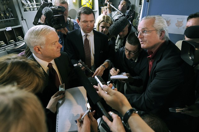 Associated Press National Security Writer Bob Burns, right, queries Defense Secretary Robert M. Gates onboard a Dover Air Force Base C-17 Globemaster aircraft prior to departing from Riyadh, Saudi Arabia, for Baghdad, April. 6, 2011.